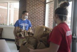 RBHS students pick up the extra packed lunches on April 20, at Riverside Brookfield High School. | ALEX ROGALS/Staff Photographer