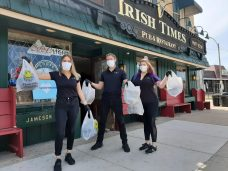 Irish Times managers Lauren Lynch (far left) and Nicole Nasir (right) and Irish Times owner, Martin Lynch (center) have pivoted from 1-percent carryout to 100-percent during the COVID-19 pandemic. (Melissa Elsmo/Contributor)