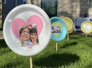 Photos and written memories, affixed to plastic plates and planted in the front lawn of the Polcyn home in Brookfield, are way for family and friends to grieve and pay respects for their their friend Carol Polcyn. | Photo by Bob Uphues/editor