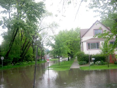 The intersection of Harrison and Madison avenues in Brookfield was flooded completely on the evening of May 17. (Photo by Steven Lifka)