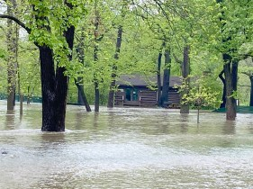 The park around the Scout Cabin in Riverside was completely flooded Monday morning, with a swift current passing through. (Bob Uphues/Editor)