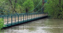 The river was so high that it nearly reached the underside of the Swinging Bridge, which connects Riverside and Riverside Lawn. (Photo by Allen Goodcase)
