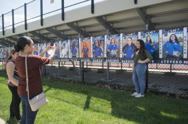 RBHS senior soccer player Elizabeth Marquez, of North Riverside, stands for a photo next to her banner on May 15, outside of the stadium at Riverside Brookfield High School (Alex Rogals/Staff Photographer).