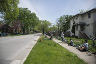 Residents line up on May 16, at the corner of Washington and Arden Avenues in Brookfield. (Alex Rogals/Staff Photographer)