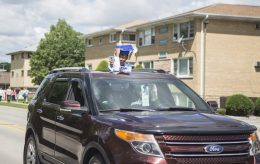 Students cheer from their cars on Saturday, May 30, 2020, during Komarek School's graduation parade along 26th Street in North Riverside. | ALEX ROGALS/Staff Photographer