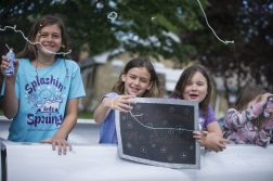 Students spray silly string from their car on Friday, May 29, 2020, during a car parade for Hollywood Elementary School in Brookfield. (Alex Rogals/Staff Photographer)
