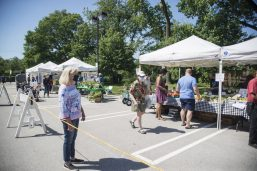 Customers wore masks and followed guidelines for physical distancing as they browsed their way through the Brookfield Farmers Market in the parking lot of the village hall during the opening day of the 2020 season on June 6. (Alex Rogals/Staff Photographer)
