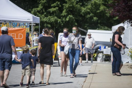 Customers wear masks and follow the guides for social distancing on Saturday, June 6, 2020, during the opening weekend of the Brookfield Farmers Market outside of Village Hall in Brookfield. (Alex Rogals/Staff Photographer)