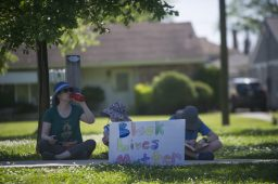Signs are seen placed on Saturday, June 6, 2020, during a Black Lives Matter protest at Kiwanis Park in Brookfield.   ALEX ROGALS/Staff Photographer