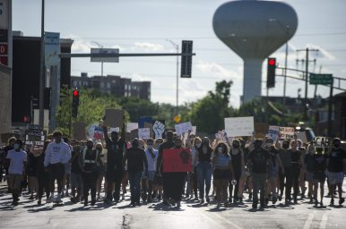 About 200 demonstrators marched through LaGrange and then down Ogden Avenue from Eberly to Maple on June 11. | Alex Rogals/Staff Photographer