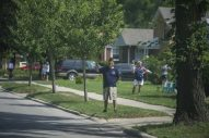 Residents wave from the front of their homes on July 4, during the Riverside 4th of July parade throughout the village. (Alex Rogals/Staff Photographer)