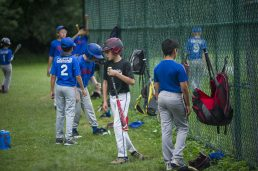 Players attempt to keep a six foot distance off of the field on Monday, July 20, 2020, during a little league baseball game at River Field on Fairbank Road in Riverside. (Alex Rogals/Staff Photographer)