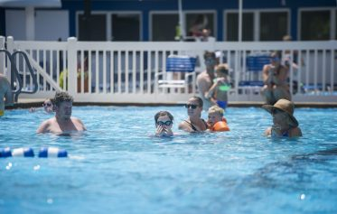 Riverside Swim Club members take a cool break from the blistering mid-90s temperatures on July 26. The swim club reopened its doors to member families on July 6 after establishing protocols to avoid crowds. (Alex Rogals/Staff Photographer)