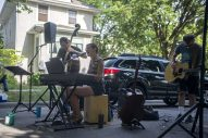 Patrick Williams, left, and Kara Kesselring perform with guitarist Gino Sigismondi during a block party session on Clarence Avenue in Oak Park on Aug. 8. (Alex Rogals/Staff Photographer)