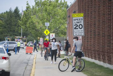 Students wear masks while leaving the school from orientation on Aug. 17, at Riverside Brookfield High School. (Alex Rogals/Staff Photographer)