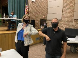 "District 96 Superintendent Martha Ryan-Toye (left) and Hollywood Community Association President Gonzo Schexnayder ""shake"" after the school board voted Aug. 19 to approve a land lease deal between the two entities. 