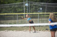 Josephine Suter serves the volleyball on Aug. 24, at Kiwanis Park in Brookfield. (Alex Rogals/Staff Photographer)