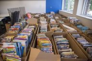 Books are ready to be put on the shelves in the new library on Sept. 2, at A.F. Ames Elementary School in Riverside. (Alex Rogals/Staff Photographer)