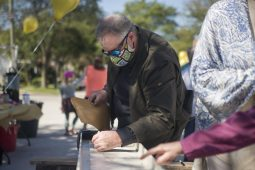 """Arthur Perry, of Brookfield, signs the beam on Sept. 19, during the """"topping off"""" ceremony at the Brookfield Public Library. (Alex Rogals/Staff Photographer)"""
