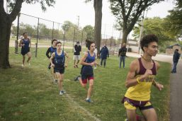Spectators cheers as the runners make their way around the course on Oct. 3, during the senior celebration meet against Northridge Prep at Elhert Park in Brookfield. (Alex Rogals/Staff Photographer)