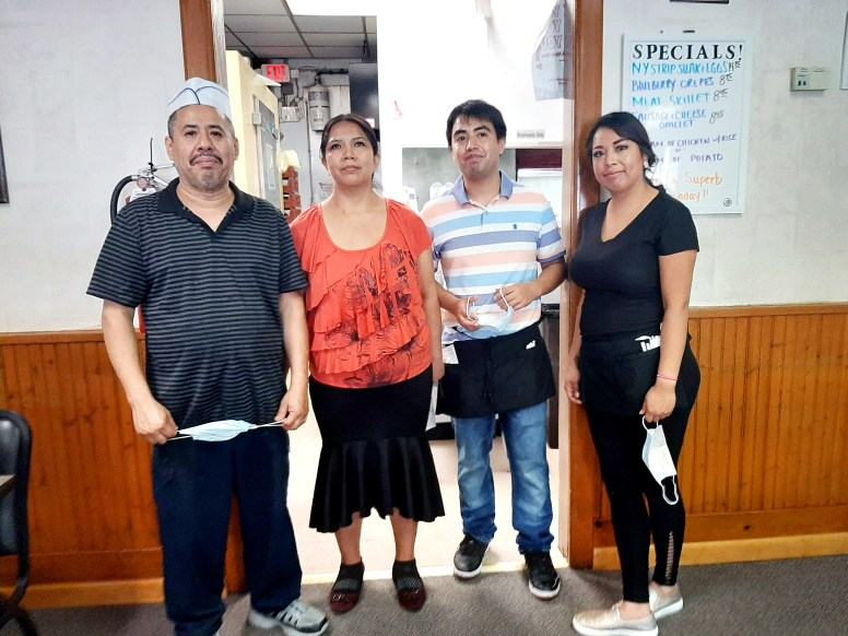 Chef Michael Guadalupe (from left) helms the kitchen while his wife, Clara, and children, Edgardo and Sandra, are the management team at Michael's Pancake House in downtown Riverside. (MELISSA ELSMO/Food Editor)