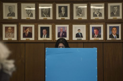 A resident votes at one of the twelve voting booths inside on Oct. 19, during the first day of early voting at Brookfield Village Hall in Brookfield. (Alex Rogals/Staff Photographer)