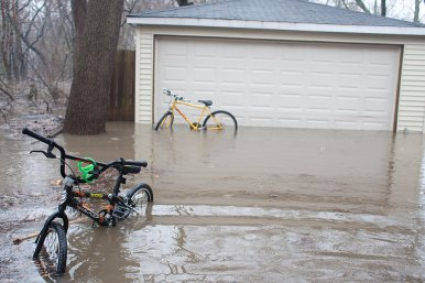 A driveway on Forest Avenue in Brookfield became part of the Salt Creek after hard rains Thursday.