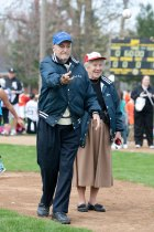 Roy Overholt, standing with his wife, Audrey, on the Kiwanis Park baseball field that bears his name, throws out the first pitch to officially open the Little League season in Brookfield. This will be the 50th year of the Roy A. Overholt Baseball Tournament.