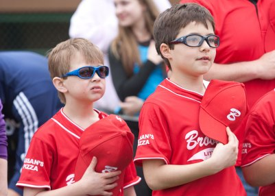 James Derrig, left, and Liam Cote, placed their hats over their hearts for the reciting of the Pledge of Allegiance during opening ceremonies for the Brookfield Little League season.