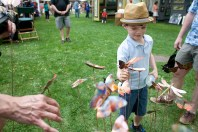 Bobby Johnson, 7, is intrigued by copper butterflies sold by a vendor.
