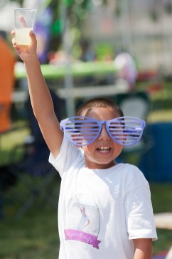 Frankie Gomez, 9, tries to entice walkers with lemonade he was selling during the Relay for Life at Jaycee/Elhert Park in Brookfield. In 12 years the event has raised more than million for cancer research.