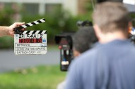 A clapper movie board signals action in front of a home at 262 Longcommon Road in Riverside.