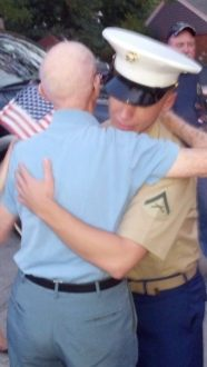 Howard Garst and Donny Strysick embrace during Strysick's homecoming parade in Hollywood on Sept. 10. Photo courtesy of Kathi Krankoski/Facebook