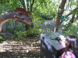 A girl operates the Dilophosaurus on the last day of the DINO'S ALIVE! experience. (photo courtesy of Chris Stach)