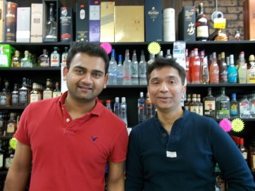 Leo's Liquors owners Aaron Patel and Bob Doshi. (photo by Chris Stach)