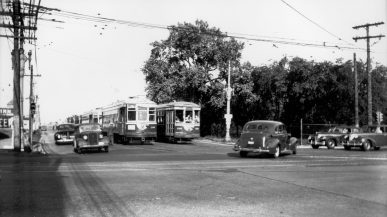 West Towns Car 140 prepares to turn south onto Harlem Avenue from Cermak Road during the late 1940s. The trees on the right were on what was then the Gage Farm property. It's now the Cermak Plaza. (Photo courtesy of the Illinois Railway Museum Library)