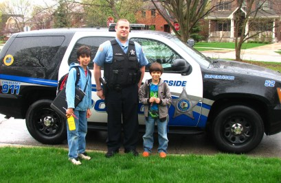 Miles (left) and Cole Rubio with Officer James Lazansky (Courtesy of the Riverside Police Dept.)