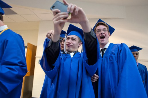 Andrew Misiorowski, center, instructs his friends, including Zachary Mullaney, to gather in for a selfie before the ceremony. (David Pierini/staff photographer)
