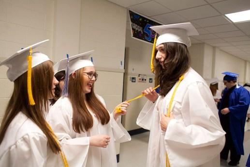 Nora Maye, center, admires the honors cord of Isabella Soluri. (David Pierini/staff photographer)