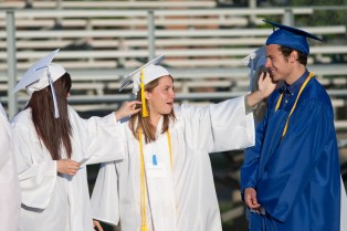 """Clare Bollnow, center, dramatically lip syncs the song """"Let it Go"""" as graduates lined up for their march onto the field. (David Pierini/staff photographer)"""