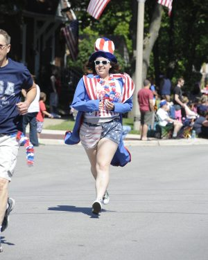 Brianna Gatch of Brookfield runs to catch up in the Brookfield parade.