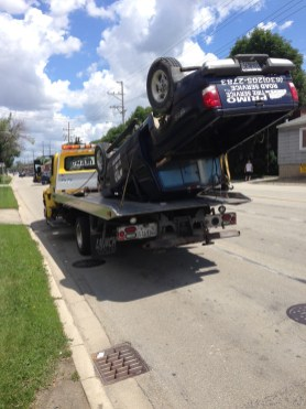 This pickup truck rolled over, losing a tire and an air compressor from its bed when it was struck by a minivan at the intersection of 47th Street and East Avenue on Wednesday morning. (Photo courtesy of Brookfield Police)