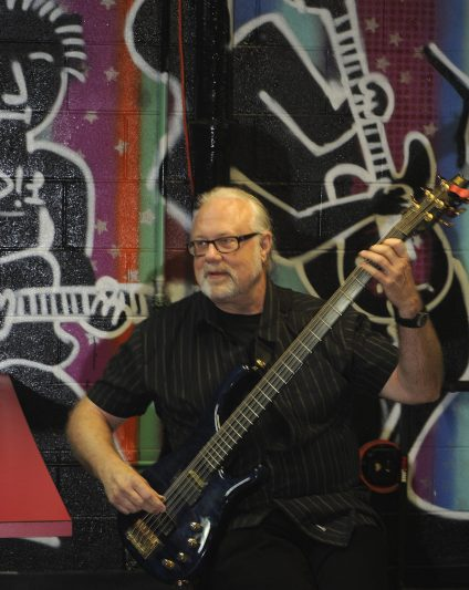 Riverside resident Dennis K. Johnson, bassist from the band Chase, will play three reunion concerts this weekend in Chicago. (JENNIFER WOLFE/Contributor)
