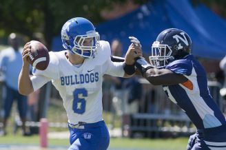 Junior Ryan Swift is an athletic, strong-armed quarterback for the Bulldogs. His maturation process has coincided with the Bulldogs' improvement in the win column. (David Pierini/Staff Photographer)