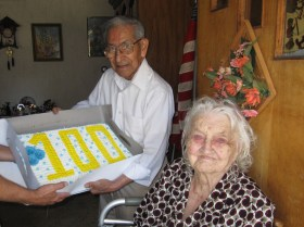 """Happy century! Last month, friends and neighbors celebrated the 100th birthday of Brookfield resident Rosie Rochas. Friends gathered to fete Rochas at the 4200 Arthur Avenue block party on Sept. 6, sang """"Happy Birthday"""" and presented her with a birthday cake. Rochas' husband, Jesse (pictured above with Rosie), and other family members gathered to celebrate with Rosie on her birthday, Sept. 21."""