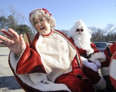 Mr. and Mrs. Claus arrive at Village Hall in Brookfield to take a sleigh ride into town during the annual Holiday Celebration Saturday. (Jennifer Wolfe/CONTRIBUTOR)