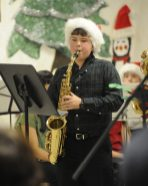 Sixth-grader Ryan Kissel plays saxophone during the S.E. Gross Middle School performance at Brookfield Village Hall. (Jennifer Wolfe/CONTRIBUTOR)