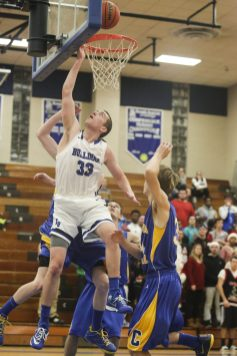 RBHS senior Sam Johnson, 33, drives the ball to the hoop against Aurora Central Catholic at Riverside-Brookfield High School on Saturday, December 13, 2014. (Chandler West/Staff Photographer)