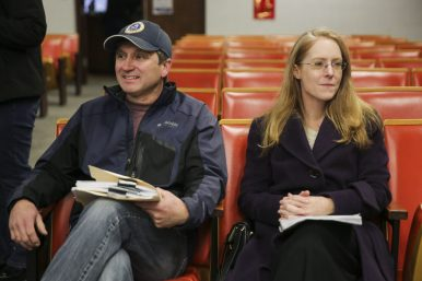 (From left) Village President Kit Ketchmark sits alongside Michelle Ryan, of the Peoples Economy party, as she waits to file paperwork to run for village trustee at the Brookfield Village Hall on Monday, December 15, 2014. | Chandler West/Staff Photographer