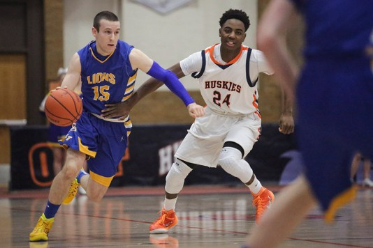 Senior guard Harrison Niego, right, is a tremendous playmaker and scorer for the Lyons Township High School boys basketball team. He'll be one of the premier players at the Jack Tosh Holiday Classic (Dec. 29-31). (Chandler West/Staff Photographer)